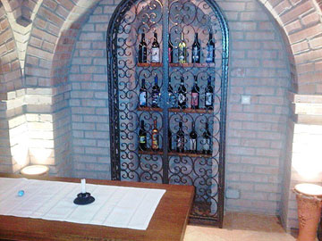 Bottles conceal the hidden door at Eszterbauer Winery