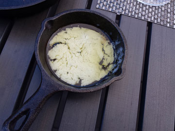 The same pan; the butter is now thoroughly melted, as though it had been on a stove
