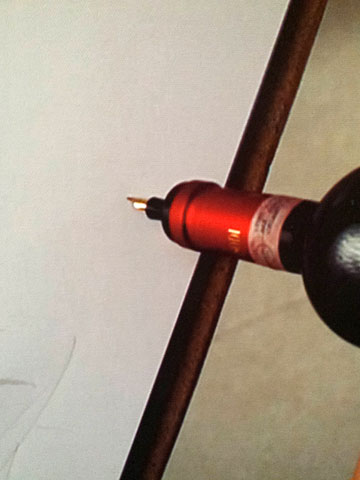 a fountain pen tip in place of the cork in a wine bottle
