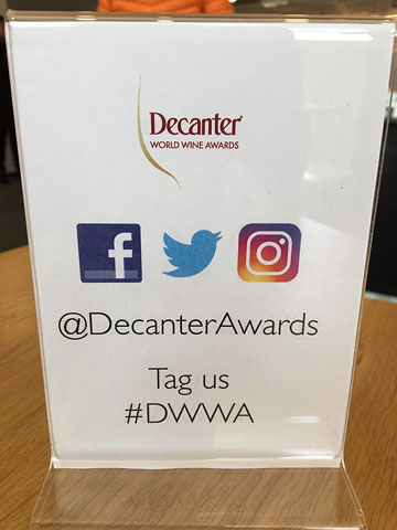 table sign: Decanter World Wine Awards | icons for Facebook, Twitter, and Instagram | @DecanterAwards | Tag us #DWWA