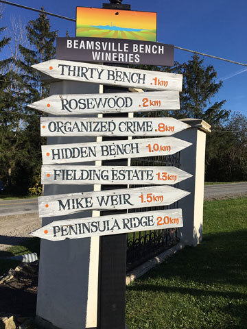 signpost showing distances and directions to seven Beamsville Bench wineries
