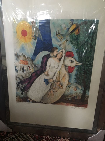 A print of Marc Chagall's 'The Couple of the Eiffel Tower' or 'Bride and Groom of the Eiffel Tower', also known as 'Bride and Groom and the Rooster'